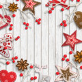 Abstract christmas background, dry branches with red berries and small scandinavian styled decorations Royalty Free Stock Photo