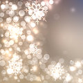 Abstract Christmas card with white and golden shining snowflakes Royalty Free Stock Photo