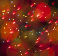 Abstract christmas light background festive lights and new year bokeh blinking Stock Images