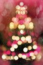 Abstract christmas tree with falling snow formed by blurred lights photo shoot during the Stock Images