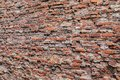 Close up of a rough brick wall with bricks on the left farther away than the right Royalty Free Stock Photo