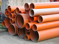 Abstract close up of a stack of orange pipes Royalty Free Stock Photo
