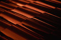 Abstract closeup metal profile roof-tile at sunset. Royalty Free Stock Photo