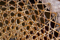 Abstract closeup of patterns and textures on wicker weave on c chair Royalty Free Stock Images