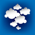 Abstract clouds or speach bubbles on blue background Stock Image