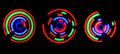 Abstract colored light circles over black background long exposure Stock Photo