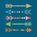 Abstract colorful aztec tribal arrows set on blue background Royalty Free Stock Images