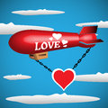 Abstract colorful background with a red blimp on which is written the word love floating among clouds Stock Photography