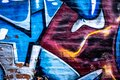 Urban abstract graffiti art background on brick wall with colors of blue white red rust and gray Royalty Free Stock Photo