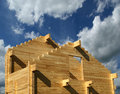 Abstract composition of new house frame construction and deep blue summer sky Stock Photo