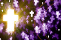 Abstract cross light background magical bokeh on black and purple Royalty Free Stock Photo