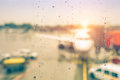 Abstract defocused bokeh of airplane in airport gate at sunset