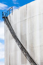 Abstract detail of a high and long stair case of an oil refinery Royalty Free Stock Photo
