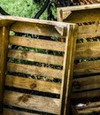 Abstract developed picture of two old ugly empty cheap wooden boxes Royalty Free Stock Photo