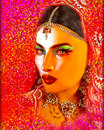 Abstract digital art of Indian or Asian woman's face, close up with colorful veil. An oil paint effect and glowing lights are adde Royalty Free Stock Photo