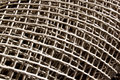 Abstract dirty plastic mesh an view of a roll of white in daylight outdoors Stock Photography