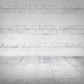 Abstract empty white interior with bricks brick wall and concrete floor Stock Photos