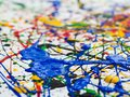 Abstract expressionism art creative background. art of splashes and drips . red black green yellow blue paint on white background