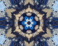 Abstract extruded mandala with blue, brown, white