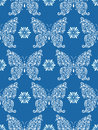 Abstract floral butterflies on blue background Royalty Free Stock Photo