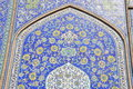 Abstract floral design tiles glazed at imam mosque or formerly shah jameh abbasi mosque in isfahan iran is unesco world heritage Royalty Free Stock Image