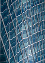 Abstract forms of sun reflections in glass building Stock Photo