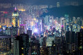 Abstract futuristic night cityscape hong kong aerial view with illuminated skyscrapers panorama Royalty Free Stock Image
