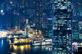 Abstract futuristic night cityscape hong kong aerial view with illuminated skyscrapers panorama Royalty Free Stock Photos
