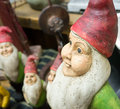 Abstract garden gnomes closeup of one gnome and a few of his brothers boked in the background Stock Photography