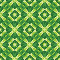 Abstract geometric background - seamless vector pattern in green colors. Ethnic boho style. Mosaic ornament structure. Royalty Free Stock Photo
