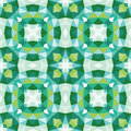 Abstract geometric background - seamless vector pattern in green colors. Ethnic boho style. Mosaic ornament structure.