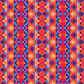 Abstract geometric background - seamless vector pattern in red, oink and blue colors. Ethnic boho style. Mosaic ornament structure Royalty Free Stock Photo