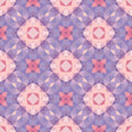 Abstract geometric background - seamless vector pattern in violet, pink and lilac colors. Ethnic boho style. Mosaic ornament.