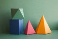 Abstract geometrical solid figures still life. Colorful three-dimensional pyramid prism rectangular cube arranged on
