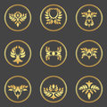 Abstract gold foliate elements.