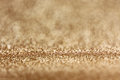 Abstract golden glitter lights and bokeh background Royalty Free Stock Image