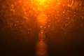 Photo : Abstract golden light flare leaks with gold particles  decorative