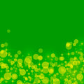 Abstract green background with yellow bokeh circles an Royalty Free Stock Photo