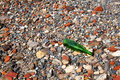 Abstract Grey Red Stones And Green Bottle Royalty Free Stock Photo