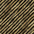 Abstract grunge seamless pattern with golden glittering acrylic paint diagonal stripes on black background Royalty Free Stock Photo