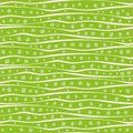 Abstract hand drawn wavy doodle lines and dots design in random placement. Vector seamless pattern on vibrant green