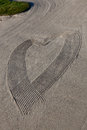 Abstract heart in sand a drawn the with a rake a golf course trap Stock Images