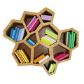 Abstract hexagonal shelf full of multicolored books, isolated on white background Stock Photo
