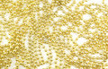 Abstract Holiday Gold Bead Background Stock Images