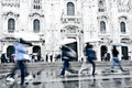 Abstract image of commuters in milan intentionally motion blurred a european city a rainy day shot italy Royalty Free Stock Image
