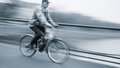Abstract image of cyclist on the city roadway intentional motion blur Royalty Free Stock Photos