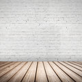 Abstract interior wooden floor and white wall with brick Royalty Free Stock Image