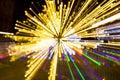 Abstract lightburst camera zoom movement yellow green purple lights Royalty Free Stock Photo