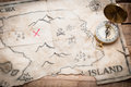 Abstract map of treasure island with gold compass on wood table Royalty Free Stock Photo