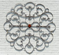 Abstract metal decoration decorative wrought iron on a painted white brick wall Royalty Free Stock Photography